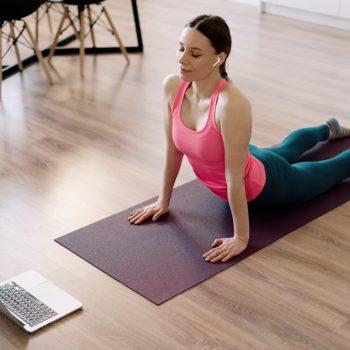 caucasian-woman-practicing-yoga-home (1)-min